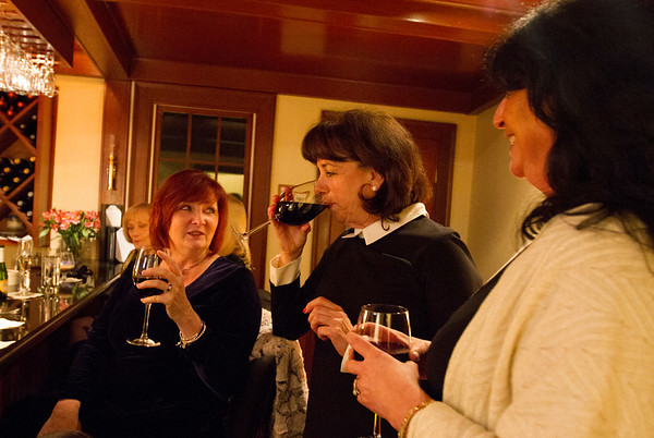 Sue Cavalieri, June Foster and Pam Day enjoy a drink at the Harbor Light Inn's annual Oscar party. Photo by Maria Uminski