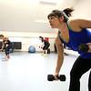 KEN YUSZKUS/Staff photo.   Dawn Johns participates in Kathy Glabicky's Tread Tabata workout.  01/14/15