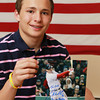 """Marblehead: Thirteen-year-old Cole Garaventi, a student at Marblehead Veterans Middle School, sold bracelets to donate money to One Fun Boston after the Boston Marathon Bombing on April 15th, 2013. Garaventi ordered 5,000 blue and yellow bracelets with the inscription """"Pray for Boston"""" and """"April 15, 2013"""" on them and has raised over $10,000 over a three week span. Garaventi was sent an autographed picture from Boston Red Sox third baseman Will Middlebrooks after the Sox star heard of Garaventi's efforts to help the One Fund. David Le/Marblehead Home & Style"""