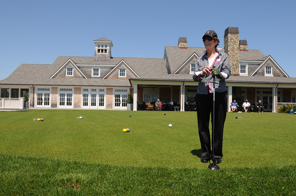 MARBLEHEAD HOME AND STYLE Magazine:<br /> Club member Patti Pignato of Marblehead looks out over the golf course from the first tee in front of the clubhouse at Tedesco Country Club before starting her game.<br /> <br /> Photo by Ken Yuszkus, Monday May 27, 2013.