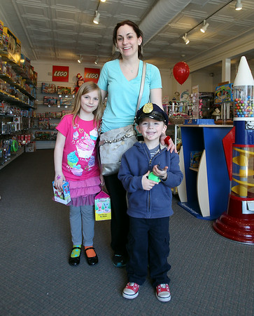 Melissa Buswell, with her children Samantha, 6, and Weston, 3, inside the Marblehead Toy Shop during Marblehead's Spring Fling on Saturday afternoon. DAVID LE/Staff photo. 4/12/14
