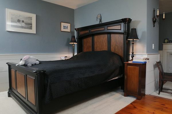 KEN YUSZKUS/Staff photo.  Rhod and Vicky Sharp own the house at 22 Franklin Street in Marblehead. The master bedroom.          5/7/14