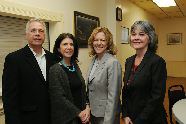 """KEN YUSZKUS/Staff photo.  From left, Chamber president George Barbuzzi, Chamber executive director Deb Payson, NOBMG publisher Karen Andreas, and past chamber president Cindy Latham attend the breakfast at the Marblehead Chamber of Commerce where NOBMG publisher Karen Andreas was presenting """"Forward Thinking Communications Strategies — Top of Your Game"""".  5/22/14."""
