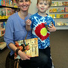 Michelle Wright-Saunders, and her son James, 4, of Swampscott inside the Marblehead Toy Shop during Marblehead's Spring Fling on Saturday afternoon. DAVID LE/Staff photo. 4/12/14