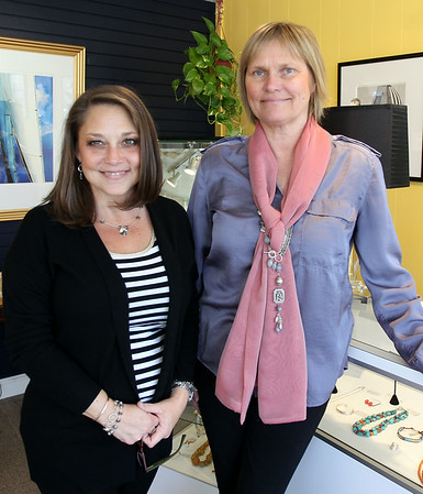 Lynnea Williamson, designer of the Nolen de Visme jewelry line featured inside Jambu, and Laura Herhold, manager of Jambu during Marblehead's Spring Fling on Saturday afternoon. DAVID LE/Staff photo. 4/12/14