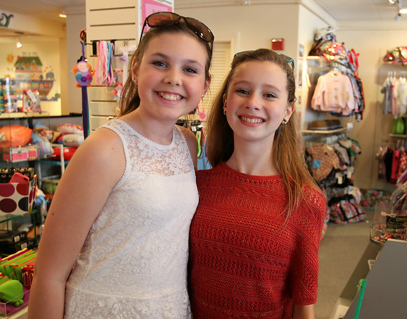 Twelve-year-olds Haley Lemieux, left, and Claudia Hart inside Pint Size and Up during Marblehead's Spring Fling on Saturday afternoon. DAVID LE/Staff photo. 4/12/14