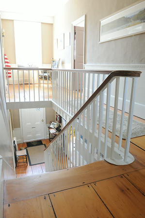 KEN YUSZKUS/Staff photo.  Rhod and Vicky Sharp own the house at 22 Franklin Street in Marblehead. looking down the stairway from the 2nd floor.         5/7/14
