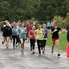 KEN YUSZKUS/Staff photo. Fit Girls Run Club of Marblehead  run around the track at the Village School in the rain. 10/16/14