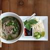 DAVID LE/Staff photo. A staple of Vietnamese cuisine, the beef pho is perfect for a cold winter afternoon. Soall Bistro in Marblehead makes four kinds of pho among other delicious Vietnamese dishes. The thinly sliced beef cooks in the broth and is accompanied by bean sprouts, Thai basil, jalapeño slices, a lime wedge and a sriracha-hoisin sauce for additional spice. 10/9/15.