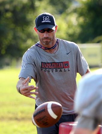 DAVID LE/Staff photo. Marblehead Offensive Coordinator Mike Giardi. 9/16/15.