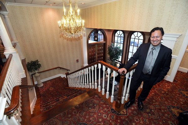 CARL RUSSO/Staff photo MIDDLETON MAGAZINE: Chris Kourkoulis, owner of Angelica's restaurant and functions in Middleton stands at the top of the grand staircase.  Although Angelica's has been serving the North Shore for 23 years, the location has been different restaurants for over 50 years. 11/02/2017