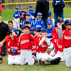 JIM VAIKNORAS/Staff photo Members of the Red Sox applaud at opening day for the Middleton Little league at the Howe Manning School.