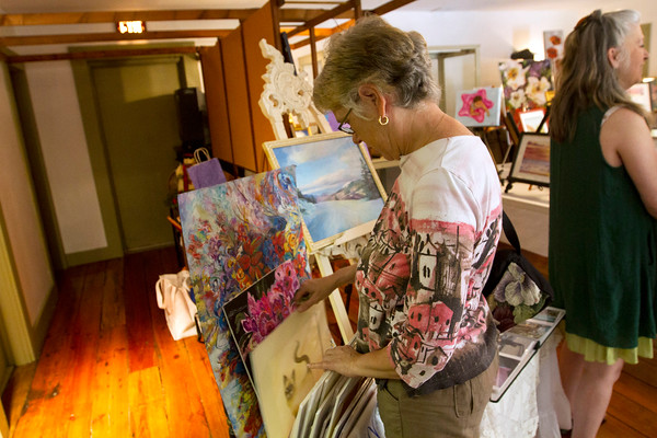 JOE DIFAZIO/ Susan Piccole a new member of the Middleton Arts Association browses through art at the group's annual art fair at the Middleton Historical Society. May 14, 2016