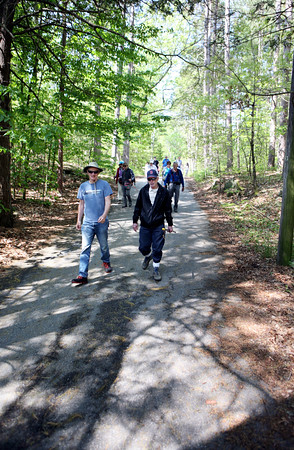 AMY SWEENEY/Staff photo. <br /> About 40 people including a school group joined the Wednesday hike on May 25, 2016 at Harold Parker State Forest.<br /> The Park Interpreter and volunteer leaders guide a slow paced walk through the forest while enjoying nature at its finest. Each week we hike to a different part of the forest for a series of 12 hikesMay 25, 2016