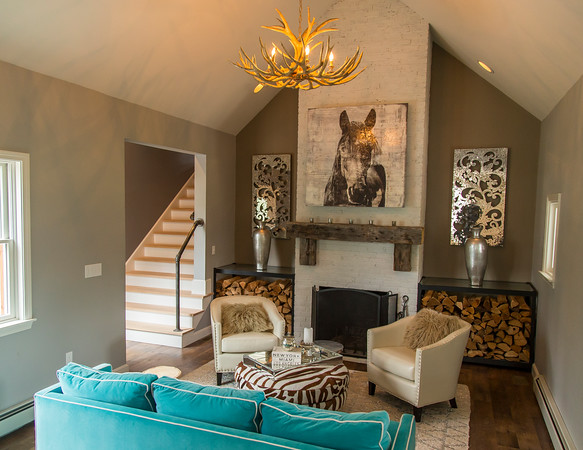 PARKER FISH/ Photo. The vibrant blue sofa and antler chandelier only adds to the allure of this uniquely designed home at 46 Baldpate Road  in Boxford. 5/21/16