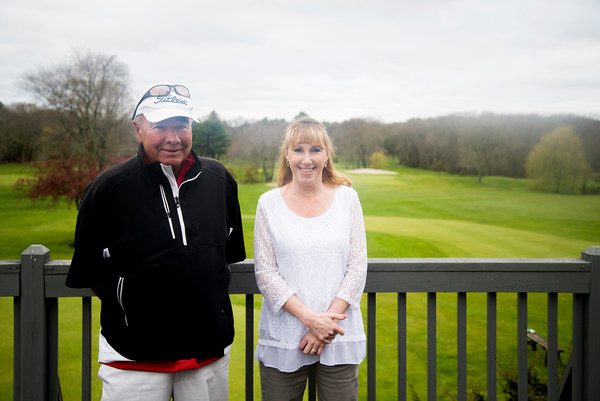 JIM VAIKNORAS/Staff photo Chris Costa and Linda.. on the deck at Middleton Golf Course