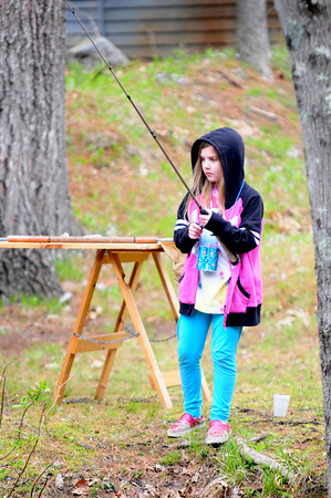 JIM VAIKNORAS/Staff photo Kaitlyn Mancini.9, of Middleton, tries her hand at fishing at a Steam Team event at Creighton Pond in Middleton.