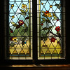 KEN YUSZKUS/Staff photo.      One of the three Middleton's Flint Public Library's stained glass windows. This is a decorative style window.    05/18/16