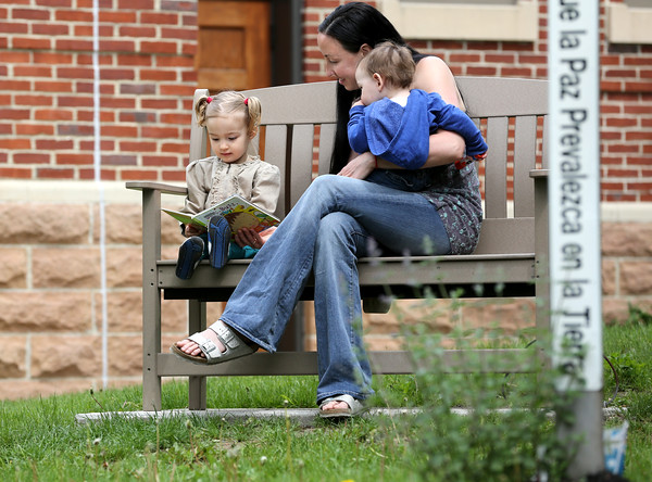 KEN YUSZKUS/Staff photo.       Briana Grieco sits with her daughter Dharma, 2, and son Bodhi, 1, in the peaceful reading garden at Middleton's Flint Public Library .    05/18/16