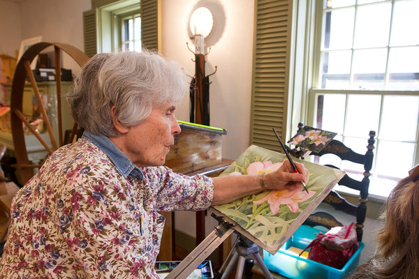JOE DIFAZIO/ Louise Anderson of North Reading works on a painting at the Middleton Art Association's annual art fair at the Middleton Historical Society. She has painted since childhood and often does painting demonstrations. May 14, 2016