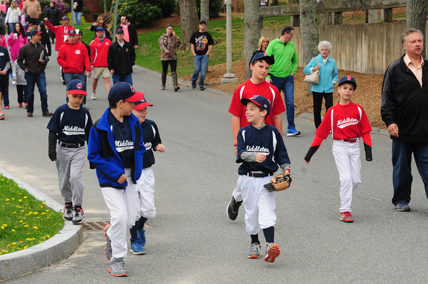JIM VAIKNORAS/Staff photo Players march at opening day for the Middleton Little league at the Howe Manning School.