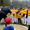 JIM VAIKNORAS/Staff photo Middleton Police Officer Tom Parland high fives player at opening day for the Middleton Little league at the Howe Manning School.