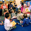 KEN YUSZKUS/Staff photo.       Far right, asst. children's librarian Darcy Bucchiere reads the children during Toddler Time in the Childrens Room at Middleton's Flint Public Library .    05/18/16