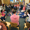 KEN YUSZKUS/Staff photo.       Far right, asst. children's librarian Darcy Bucchiere leads the children in song during Toddler Time in the Childrens Room at Middleton's Flint Public Library .    05/18/16