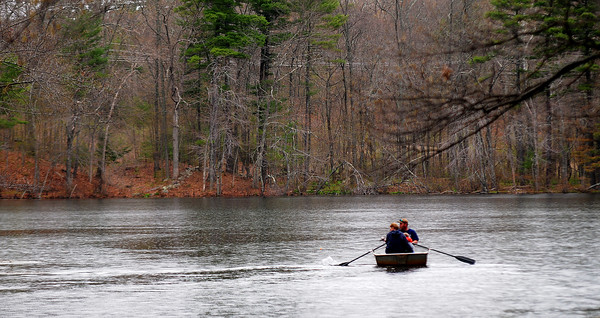 JIM VAIKNORAS/Staff photoA family take a row boat for a ride at a Steam Team event at Creighton Pond in Middleton.