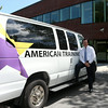 MARY SCHWALM/Staff photo Tom Connors, CEO of American Training leans against a van outside the building in Andover. 8/14/14