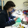 MARY SCHWALM/Staff photo Tuyet Ngo, of Lawrence, works on a circuit board during a class at American Training. 8/14/14