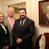 Brother and sister CR Lyons and Amanda Lyons Brinkley, with their father Kevin Lyons, center, are the owners of CR Lyons and Sons Funeral Home in Danvers. The Lyons' stand next to an old photograph of CR and Amanda's great-grandfather, hanging inside the funeral home. DAVID LE/Staff photo. 8/19/14.