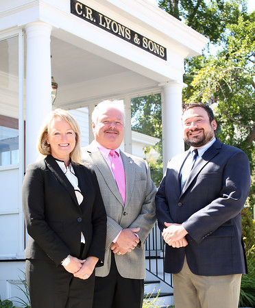 From left, Amanda Lyons Brinkley, Kevin Lyons, and CR Lyons are the owners of CR Lyons and Sons Funeral Home in Danvers. DAVID LE/Staff photo. 8/19/14.