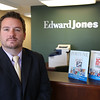 KEN YUSZKUS/Staff photo. Dan Brothers, is a financial advisor at the Swampscott office of Edward Jones,  8/14/14
