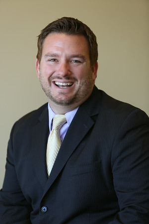 KEN YUSZKUS/Staff photo. Dan Brothers, is a financial advisor at the Swampscott office of Edward Jones,  8/14/14