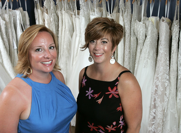 KEN YUSZKUS/Staff photo.   Lisa Almeida, left, and Heidi Nicholson  are not only co-owners of a wildly successful bridal salon, Bella Sera Bridal & Lorraine Roy at Bella Sera Bridal, they are image consultants, philanthropists, and best friends.      7/9/14
