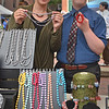 Elise Snow (l) and Michael display the jewelry created as part of the North Shore Arc and sold at the Salem Farmer's Market.<br /> <br /> Photo by JoeBrownPhotos.com