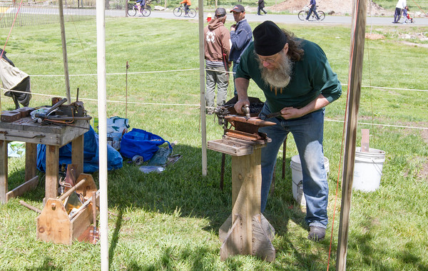 Joe Difazio/ Theodore Hinman of Greenfield creates metal work art with bygone techniques at the Family Festival at Brooksby Farm in Peabody. May 15, 2016