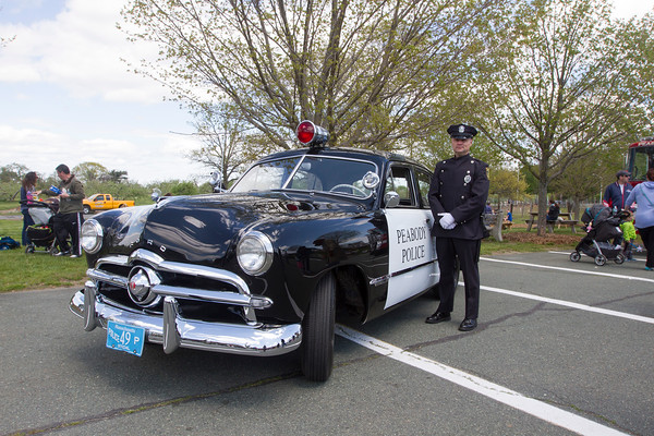 Joe Difazio/ Officer Joe Coup of the Peabody Police Department with an old police cruiser at the  Family Festival at Brooksby Farm in Peabody. May 15, 2016
