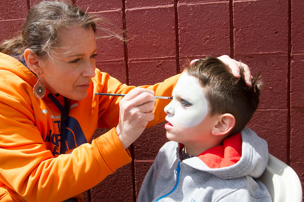 Joe Difazio/ Aidan Ewing, seven, of Peabody having his face painted by Pam Oliveri, also of Peabody at the Family Festival at Brooksby Farm in Peabody. May 15, 2016