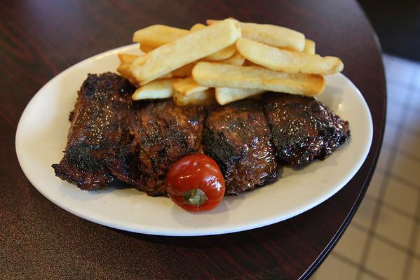 KEN YUSZKUS/Staff photo.   The steak tip dinner which is their signature dish at Champion's Pub in Peabody.    07/12/16