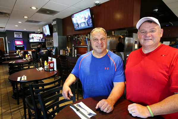 KEN YUSZKUS/Staff photo.   Co-owners of Champion's Pub in Peabody, Phil Mitchell, left, and Kevin Houlden.    07/12/16