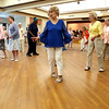 KEN YUSZKUS/Staff photo.      Dancing to a polka by the Golden Echoes Dance Band at the Peter A. Torigian Senior Center in Peabody.        06/16/16