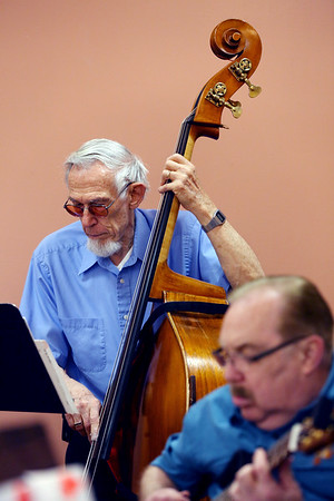 KEN YUSZKUS/Staff photo.     Double bass player Marvin Drake plays with the Golden Echoes Dance Band at the Peter A. Torigian Senior Center in Peabody.        06/16/16