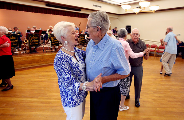 KEN YUSZKUS/Staff photo.      Mary Santos and John Myers dance to the music of the Golden Echoes Dance Band at the Peter A. Torigian Senior Center in Peabody.        06/16/16
