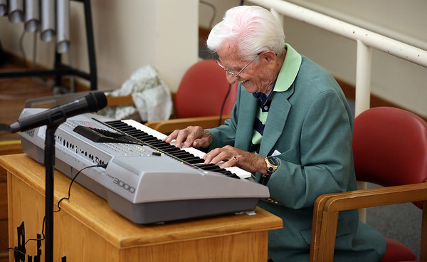KEN YUSZKUS/Staff photo.    Joe Macrina, not only comes to dance, but he provides the organ music during the break for the Golden Echoes Dance Band at the Peter A. Torigian Senior Center in Peabody.       06/16/16