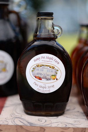 PAUL BILODEAU/Staff photo. An 8oz bottles of maple syrup from Honey Pot Maple Farm during the Peabody's Farmers' Market, which is held at City Hall on Tuesday from 1-6:30pm.