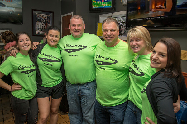 PARKER FISH/Photo. Owners Phil Mitchell and Kevin Holden pose for a photo with their family members Jodi Mitchell, Nicole Mitchell, Kellie Multner and Caty Houlden 5/5/16
