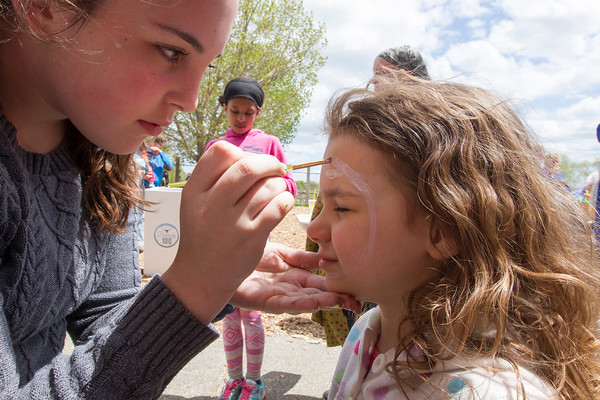 Joe Difazio/ Saoirse Mulvany, five, of Saugus having her face painted by Olivia Gardicas of Peabody at the Family Festival at Brooksby Farm in Peabody. May 15, 2016
