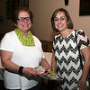 AMY SWEENEY/Staff photo.   Teresa Cappella, from Teresa's Crafters Boutique and Deanne Healey, president and CEO of the Peabody Area Chamber of Commerce. Peabody Magazine launch Party held at Toscana's Ristorante May 12, 2016